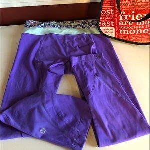 Like new Lululemon's 3/4 purple outside zipper